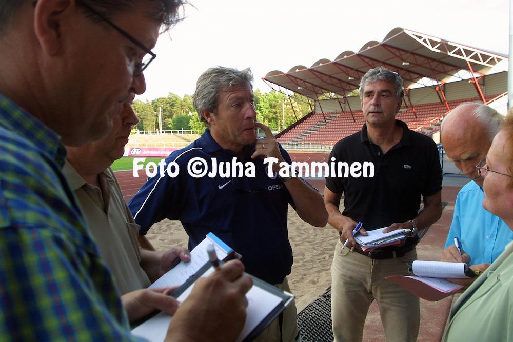 08.07.2001, Pori, Finland. UEFA Intertoto Cup, 2nd round, 2nd leg match, FC Jazz Pori v Paris Saint-Germain. Coach Luis Fernandez (PSG) being interviewed by the local press after the match..©JUHA TAMMINEN