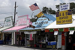 11june 2010. Westwego, Louisiana. <br /> The Shrimp Lot in Westwego just outside New Orleans. Ordinarily the market would be crammed with people on a Friday aftrenoon. Today it is virtually deserted. Incomes have crashed as all seafood prices have risen over 30% in the past 4 weeks alone as stocks run low thanks to closed fishing grounds affected by oil pollution. BP's disastrous environmental catastrophe out in the Gulf of Mexico threatens  the livelihood of many thousands of workers affiliated to the fishing industry in Louisiana. Earnings are down as much as  50% of those pre BP's oil disaster. Thousands of barrels of oil per day continues to leak into the Gulf because of the explosion and collapse of the Deepwater Horizon drilling platform 46 miles out to sea. The closure of fishing grounds both east and west of the Mississippi river outflow is crippling thousands of local fishermen and all affiliated businesses and families who rely on the seafood industry. None of the shrimp or other seafood offered at the market are fresh catch from today. Everything has been through the IQF (Instant Quick Freeze) process and is seafood caught out of state or earlier in the season and brought from storage freezers in Venice and Grand Isle. Louisiana stocks are virtually non-existent. With few new catches, the market will be forced to rely on farmed shrimp shipped in from Texas and Georgia. Local traders refuse to stock Chinese import fish raised with growth hormones, pesticides, fungicides and other contaminants widely found in Chinese farm raised seafood. Many fear losing their jobs and everything they own as a result of BP's Gulf Coast environmental disaster.<br /> Photo; Charlie Varley/varleypix.com