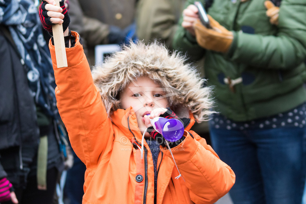 London, February 27th 2016. A young boy blows his horn during CND's march and rally opposing the UK's Trident nuclear weapons programme. <br /> ©Paul Davey<br /> FOR LICENCING CONTACT: Paul Davey +44 (0) 7966 016 296 paul@pauldaveycreative.co.uk