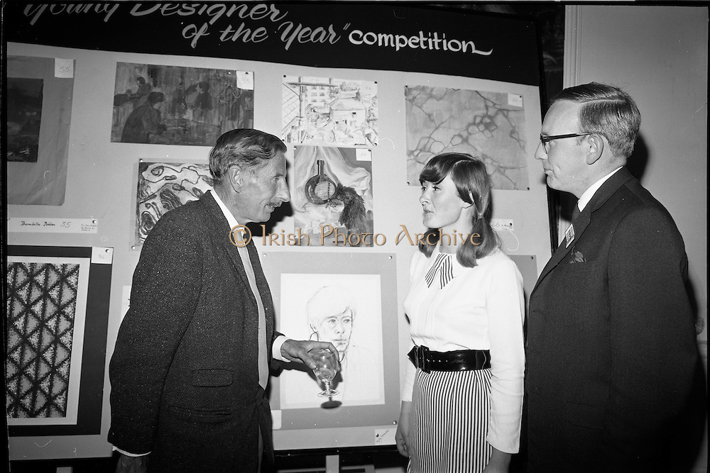 "28/06/1967<br /> 06/28/1967<br /> 28 June 1967<br /> Presentation of prizes at Navan Carpets ""Young Designer of the Year"" reception in the Royal Hibernian Hotel, Dublin. Image shows Mr. Michael Bourke, Principal of the National College of Art Miss June M. Clampett and Mr. J. Short, Navan Carpets Ltd. in front of Miss Clampett's work."