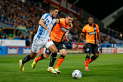 Tommy Smith of Huddersfield Town is challenged by Danny Holla of Brighton - Photo mandatory by-line: Rogan Thomson/JMP - 07966 386802 - 21/10/2014 - SPORT - FOOTBALL - Huddersfield, England - The John Smith's Stadium - Huddersfield Town v Brighton & Hove Albion - Sky Bet Championship.