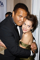 October 23, 2004 - Beverly Hills, California, U.S. - Sports legend MUHAMMAD ALI embraces actress BRITTANY MURPHY at ''Mercedes-Benz Presents The 16th Annual Carousel of Hope Benefitting the Barbara Davis Center For Childhood Diabetes''. (Credit Image: © Starmax/Newscom via ZUMA Press)