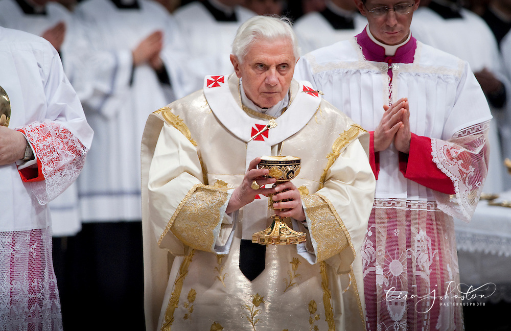Pope Benedict XVI readies to distribute the Holy Eucharist during communion at Mass on the Solemnity of Mary the Mother of God.