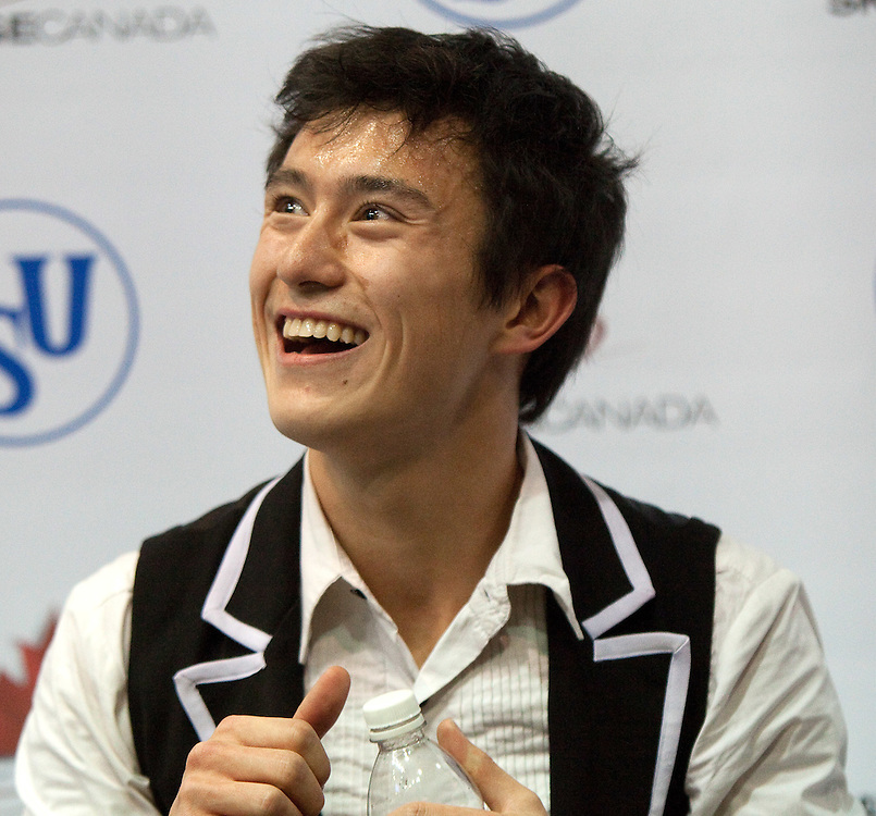 GJR357 -20111028- Mississauga, Ontario,Canada-  Patrick Chan of Canada skates smiles as he awaits his marks in the short program at Skate Canada International, October 28, 2011.<br /> AFP PHOTO/Geoff Robins