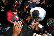 Anti government protestors clash with Army troops in Bangkok, Thailand on Saturday, April 10, 2010