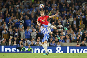 Manchester United Defender Luke Shaw battles for header with Brighton and Hove Albion forward Glenn Murray (17) during the Premier League match between Brighton and Hove Albion and Manchester United at the American Express Community Stadium, Brighton and Hove, England on 4 May 2018. Picture by Phil Duncan.