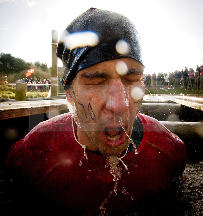 "©  London News Pictures. 27/01/2013.  A Competitor surfacing from freezing cold water during the 2013 Tough Guy Challenge on January 27, 2013 in Wolverhampton, England. The event has been widely described as ""the toughest race in the world"", with over one-third of the starters failing to finish in a typical year. Photo credit: Ben Cawthra"