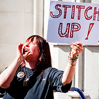 LONDON, UK - 30th May 2012: a protester holds a sign reading 'Stitch Up!' outside The Supreme Court in London, minutes after Assange's loss of his extradition appeal.
