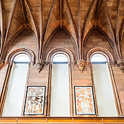 Smithsonian Castle Architecture Interior West Wing Hall. Formally known as the Smithsonian Institution Building, the Smithsonian Castle houses the administrative headquarters fo the Smithsonian Institution as well as some a permanent exhibition titled Smithsonian Institution: America's Treasure Chest. It's distinctive architectural style stands out on the southern side of the National Mall in Washington DC.