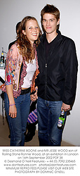 MISS CATHERINE BOONE and MR JESSE WOOD son of Rolling Stone Ronnie Wood, at an exhibtion in London on 16th September 2002.	PDF 38