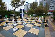 Chess game and police booth in the rain.