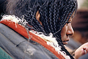 TIBET. detail/close up of nomad woman, finely braided hair