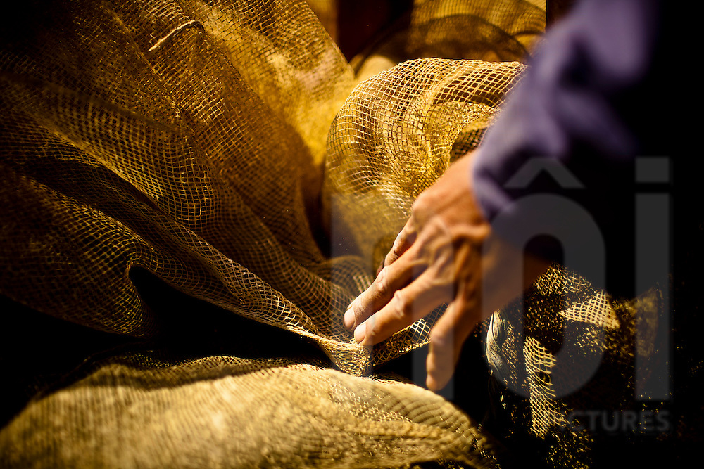 Detail of a hand holding fishing nets, Yen Bai Province, Vietnam, Southeast Asia