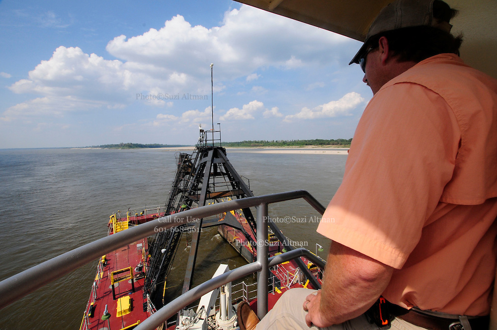 {8/24/12} {10pmCST} -JOB # 42286- Greenville , MS, U.S.A. --Charles F. Ashley ,Asst. Master, od the Dredge JADWIN, of the US Army Corp of Engineers, watches as the dredging begins 7miles downriver from Greenville MS. where the Army Corp of Engeineers is dredging the river to keep it open to tug boat traffic. Sandbars creep up as the water level drops on the Mississippi River makeing navigating the Mississippi River difficult for tug boat captains Ron Mook , Friday August 24,2012. Historically low river levels on the Mississippi River are causing havoc on river traffic: grounding barges loaded with grain and fertilizer, traffic jams several miles long and forcing the Coast Guard to close down chunks of the river due to groundings. The area around Greenville, Miss., has closed three times the past week due to groundings. Last year, there were five total groundings the entire low-water season. Locals who fought historic high-water floods last year are this year engaged in a different fight: keeping barges afloat on a vanishing Mississippi.  -- Photo by Suzi Altman, Freelance.