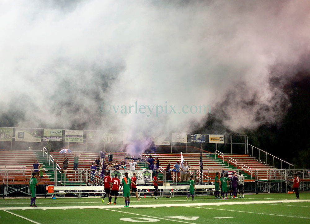 24 June 2015. New Orleans, Louisiana.<br /> National Premier Soccer League. NPSL. <br /> Jesters 0 - Atlanta Silverbacks 1.<br /> The New Orleans Jesters lose 0-1 to the Atlanta Silverbacks in a lightning delayed game at home in the Pan American Stadium. Jesters supporters of The Royal Court release smoke at the end of the game.<br /> Photo©; Charlie Varley/varleypix.com