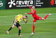 Phoenix' Hamish Watson is caught in a heavy challenge by Adelaide United's Dylan McGowan during the Round 22 A-League football match - Wellington Phoenix V Adelaide United at Westpac Stadium, Wellington. Saturday 5th March 2016. Copyright Photo.: Grant Down / www.photosport.nz