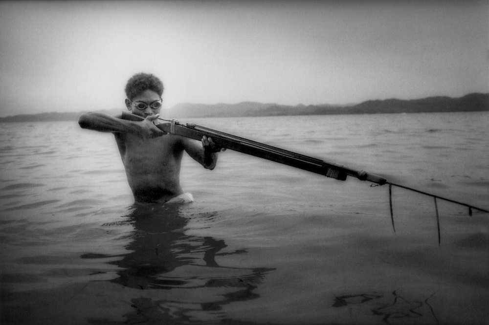 Baker (a Dumagat Negrito man) with speargun, Palaui Island, Philippines.