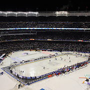 A panoramic view of Yankee Stadium during the New York Rangers Vs New York Islanders  NHL regular season game held outdoors at Yankee Stadium, The Bronx, New York, USA. 29th January 2014. Photo Tim Clayton