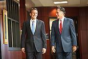 Gov. Mitt Romney walks with Gov. Tim Pawlenty on September 12, 2011 in North Charleston, South Carolina.  Pawlenty who quit the Republican nomination last month endorsed Romney for President.