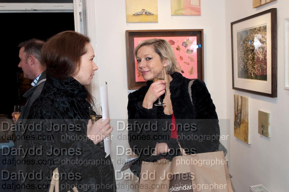 GOSIA CZYZ; HEIDI BACKMAN, Christmas Salon at Eleven. Eccleston st. London. 9 December 2010. -DO NOT ARCHIVE-© Copyright Photograph by Dafydd Jones. 248 Clapham Rd. London SW9 0PZ. Tel 0207 820 0771. www.dafjones.com.