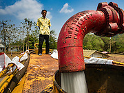 16 MARCH 2016 - PRACHIN BURI, PRACHIN BURI, THAILAND: A worker refills a water tanker truck for before taking water to Abhaibhubet Hospital in Prachin Buri. The drought in Thailand is worsening and has spread to 14 provinces in the agricultural heartland of Thailand. Communities along the Bang Pakong River, which flows into the Gulf of Siam, have been especially hard hit since salt water has intruded into domestic water supplies as far upstream as Prachin Buri, about 100 miles from the mouth of the river at the Gulf of Siam. Water is being trucked to hospitals in the area because they can't use the salty water.        PHOTO BY JACK KURTZ