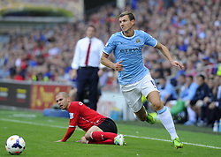 Manchester City's Edin Dzeko escapes the attention of Cardiff City's Matthew Connolly  - Photo mandatory by-line: Joe Meredith/JMP - Tel: Mobile: 07966 386802 25/08/2013 - SPORT - FOOTBALL - Cardiff City Stadium - Cardiff -  Cardiff City V Manchester City - Barclays Premier League