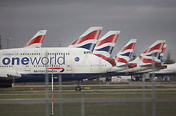"""© Licensed to London News Pictures. 17/03/2020. London, UK. A British Airways 747 Jumbo taxis past a line of parked aircraft at Heathrow's Terminal Five. The Airport Operators Association has said that UK airports will shut down within weeks without government support. The government have advised the public that they should avoid """"non-essential"""" travel and contact with others to curb the spread of the coronavirus. Photo credit: Peter Macdiarmid/LNP"""