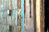 A wall with string hanging in a market in Mombasa, Kenya
