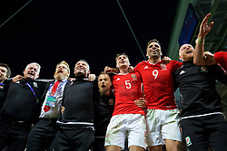 LILLE, FRANCE - Friday, July 1, 2016: Wales players celebrate in the team huddle following a 3-1 victory over Belgium and reaching the Semi-Final during the UEFA Euro 2016 Championship Quarter-Final match at the Stade Pierre Mauroy. Mike Murphy, head of international affairs Mark Evans, assistant manager Osian Roberts, Jamie Benito Plans, James Chester, Hal Robson-Kanu, physiotherapist Sean Connelly. (Pic by David Rawcliffe/Propaganda)