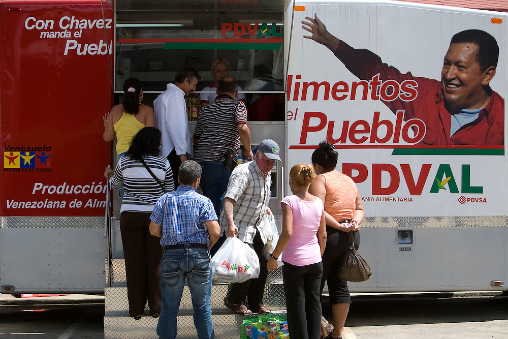 Venezuelan customers buy food and other basic needs at a nationwide food supply network called PDVAL, in the Fabricio Ojeda Nucleus of Endogenous Development. PDVAL's goal is to distribute basic goods such as meat, milk, chicken and other goods which prices are regulated by the government. Caracas, Oct. 18, 2008 (Photo/Ivan Gonzalez)