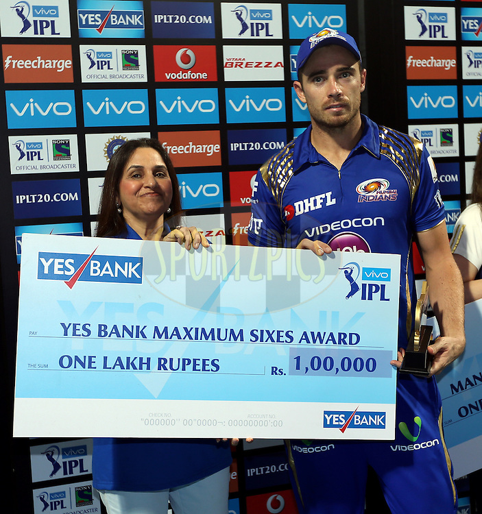 Tim Southee of Mumbai Indians receives Yes Bank Maximum sixes award during the presentation of the match 9 of the Vivo Indian Premier League ( IPL ) 2016 between the Mumbai Indians and the Gujarat Lions held at the Wankhede Stadium in Mumbai on the 16th April 2016<br /> <br /> Photo by Sandeep Shetty/ IPL/ SPORTZPICS