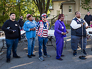 12 OCTOBER 2019 - DES MOINES, IOWA: People line up at a microphone to ask questions of Senator Kamala Harris (D-CA) in Des Moines Saturday. Sen. Harris attended a neighborhood block party in Des Moines as a part of her campaign to be the Democratic nominee for the US presidency in 2020. Iowa traditionally holds the first selection of the presidential election cycle. The Iowa caucuses are Feb. 3, 2020.        PHOTO BY JACK KURTZ