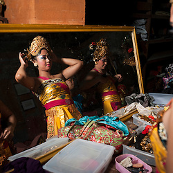 Balinese dancers getting ready for a show in Ubud, Bali, Indonesia