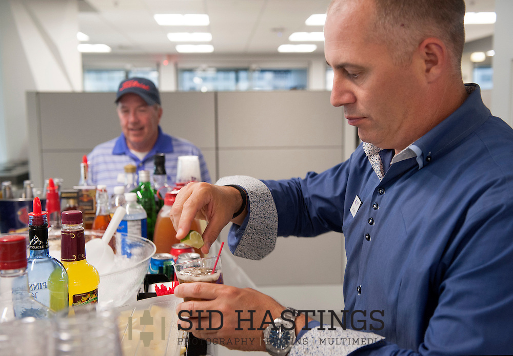 2 JUNE 2016 -- ST. LOUIS -- Anders CPAs + Advisors partners Dan Mudd (right) and Thomas Helm tend bar at the fifth hole on the putt-putt course laid out among the offices at the company in downtown St. Louis as part of Putt and Prosper 2016 Thursday, June 2, 2016. An after work happy hour sponsored by Anders' Young Professional Group for employees, customers and friends, Putt and Prosper scattered putt-putt holes throughout the firm's offices and raised funds for Stray Rescue of St. Louis. Photo © copyright 2016 Sid Hastings.