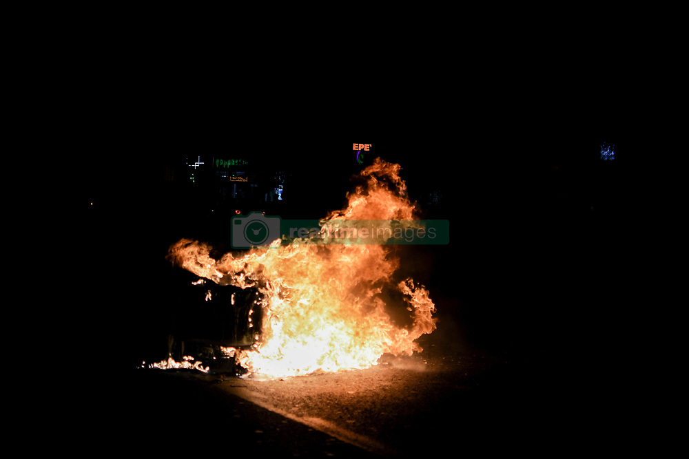 November 17, 2018 - Athens, Greece - A trash can in flames seen during the demonstration for the 45th anniversary of Polytechnic school uprising..The Polytechnic students uprising was against the military junta that was ruling Greece in 1973. (Credit Image: © Giorgos Zachos/SOPA Images via ZUMA Wire)