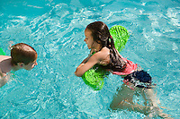 Children Playing With Float Toys in Swimming Pool