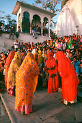 INDIA, FESTIVALS Gangaur, Hindu festival for Parvati, consort of Siva. Females dancing in Udaipur.