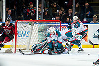 KELOWNA, CANADA - JANUARY 26:  Lassi Thomson #2 attempts to block a shot while Roman Basran #30 of the Kelowna Rockets makes a second period save against the Vancouver Giants on January 26, 2019 at Prospera Place in Kelowna, British Columbia, Canada.  (Photo by Marissa Baecker/Shoot the Breeze)