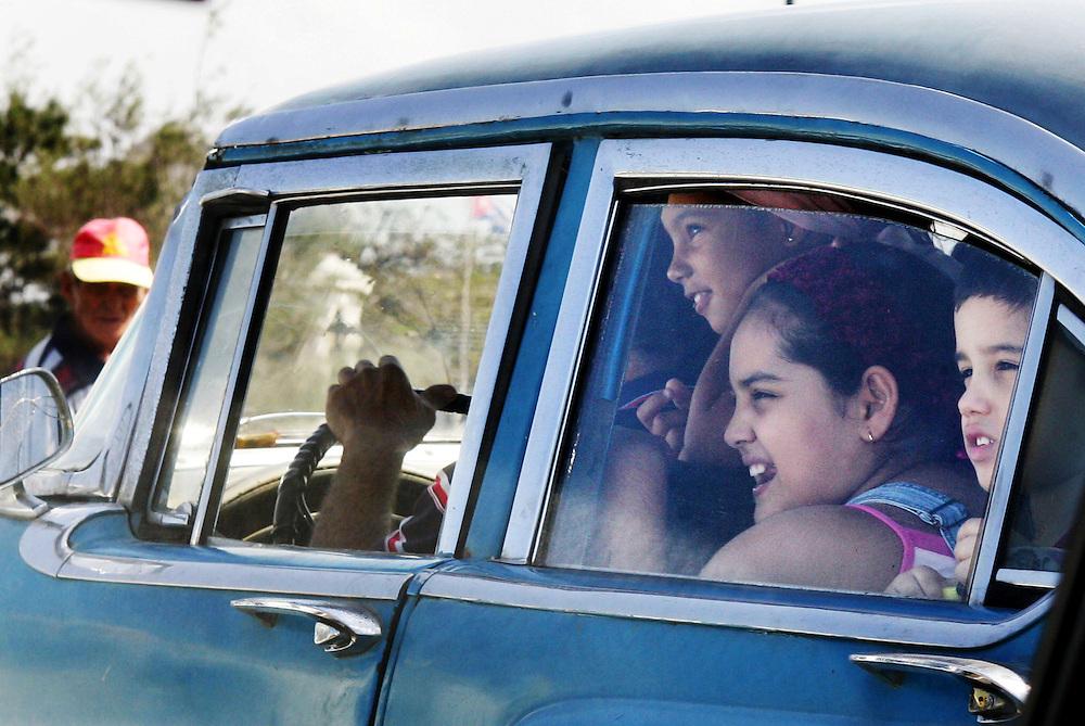 Kids in old car , Havana , Cuba.