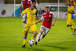 Benjamin Morel of NK Domzale and Lovro Cvek of NK Aluminij during football match between NK Domzale and NK Aluminij in 8th Round of Prva liga Telekom Slovenije 2016/17, on September 9, 2016 in Sportni Park, Domzale, Slovenia. Photo by Ziga Zupan / Sportida