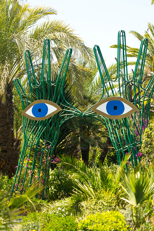 Modern art sculpture feature at the Anima Gardens by Andre Heller, Ourika Valley, Marrakesh, Morocco, 2016–04-22.<br /><br />A relatively new garden space designed by André Heller, receiving praise and attention for its imaginative and creative design. <br /><br />Located amid the foothills of the High Atlas mountains, within the spectacular Ourika Valley (27km away from Marrakesh), the Anima Garden holds shady paths and pavilions with wild flowers, cacti, water features, palm trees and tall grass, with the suprising addition of unusual sculptures of magical characters hidden about the space.
