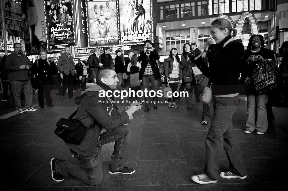 17 March 2011: A man proposes to his future wife in Times Square in New York City, NY.