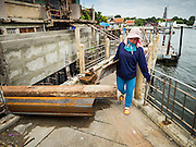 14 SEPTEMBER 2015 - BANGKOK, THAILAND: Construction workers work on the improved riverfront sidewalk between Wat Kalayanamit and Santa Cruz Catholic Church in the Thonburi section of Bangkok. The sidewalks along the Chao Phraya River are being repaired and expanded as a part of an urban renewal project along the river. The project is controversial because several neighborhoods, including one near Wat Kalayanamit are being leveled to allow for condo and retail development and gentricification.      PHOTO BY JACK KURTZ