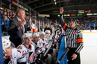 KELOWNA, BC - OCTOBER 12: Referee Tyler Adair stands at the bench speaking to head coach Shaun Clouston of the Kamloops Blazers at Prospera Place on October 12, 2019 in Kelowna, Canada. (Photo by Marissa Baecker/Shoot the Breeze)