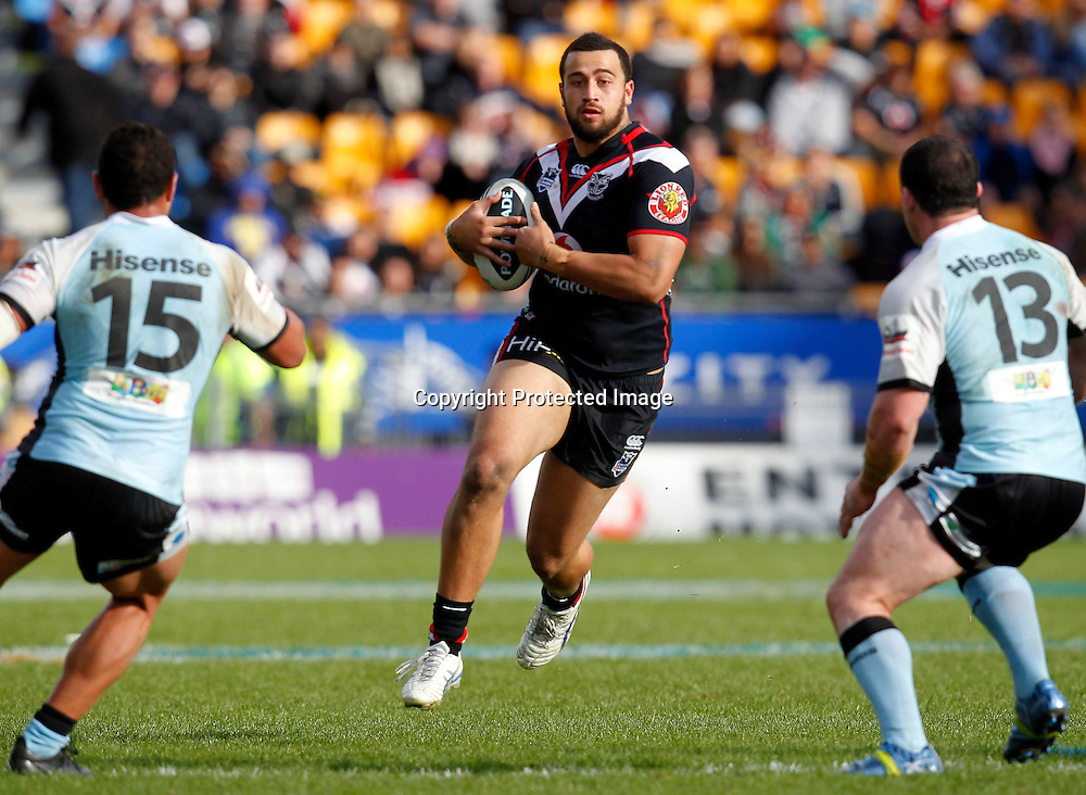 Warriors Feleti Mateo looks to evade Sharks Tyson Frizell and Paul Gallen. during the NRL game, Vodafone Warriors v Cronulla Sharks, Mt Smart Stadium, Auckland, Sunday 5 August  2012. Photo: Shane Wenzlick /photosport.co.nz