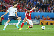 Switzerland Midfielder Blerim Džemaili beats off France Midfielder Yohan Cabaye during the Euro 2016 Group A match between Switzerland and France at Stade Pierre Mauroy, Lille, France on 19 June 2016. Photo by Phil Duncan.