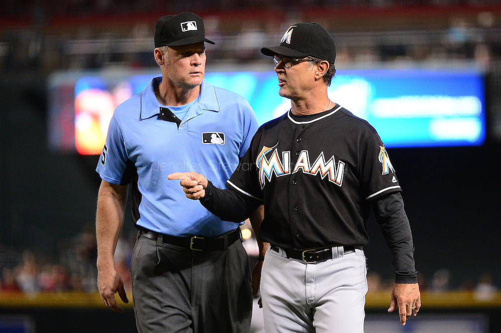 PHOENIX, AZ - JUNE 12:  Don Mattingly #8 of the Miami Marlins challenges a call on a play in the third inning to umpire Ted Barrett #65 at Chase Field on June 12, 2016 in Phoenix, Arizona.  (Photo by Jennifer Stewart/Getty Images)