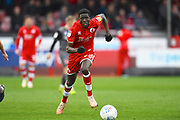 Crawley Town player Panutche Camara moves the ball down the sideline in the first half during the EFL Sky Bet League 2 match between Crawley Town and Lincoln City at The People's Pension Stadium, Crawley, England on 23 March 2019.
