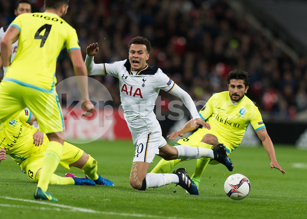 Dele Alli of Tottenham Hotspur is fouled by Kenneth Saief of KAA Gent during the UEFA Europa League  Round of 32 Game 2 match between Tottenham Hotspur and Gent at Wembley Stadium, London, England on 23 February 2017. Photo by Vince  Mignott.
