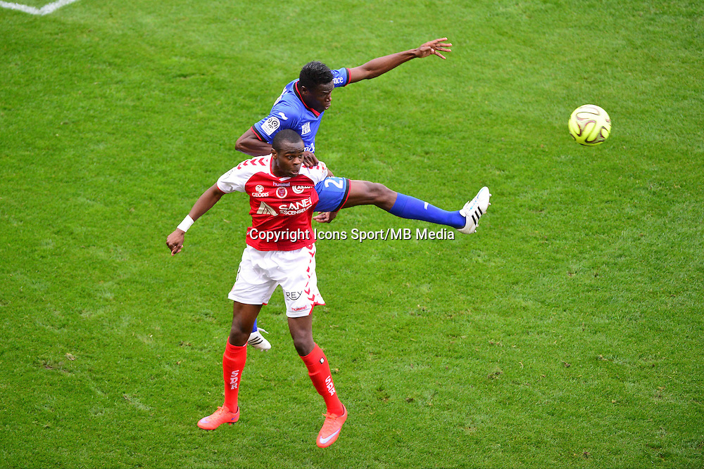 Prince ONIANGUE / Romain GENEVOIS - 12.04.2015 - Reims / Nice - 32eme journee de Ligue 1 <br />